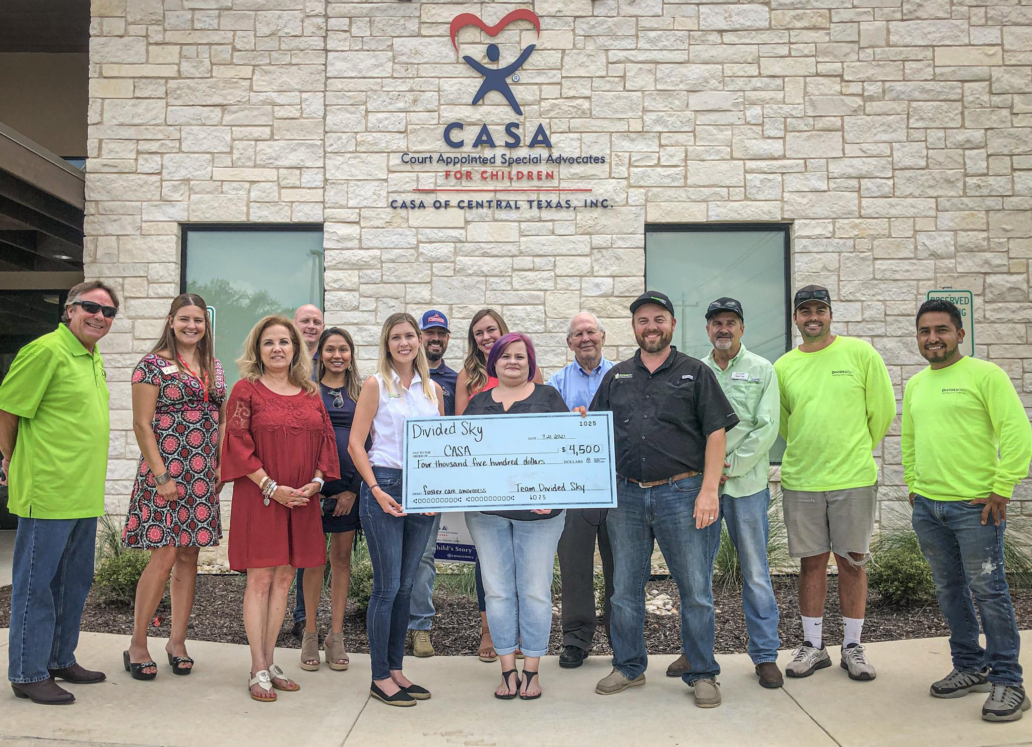 FOR THE CHILDREN: Divided Sky Roofing, Rotary Club make donations to CASA