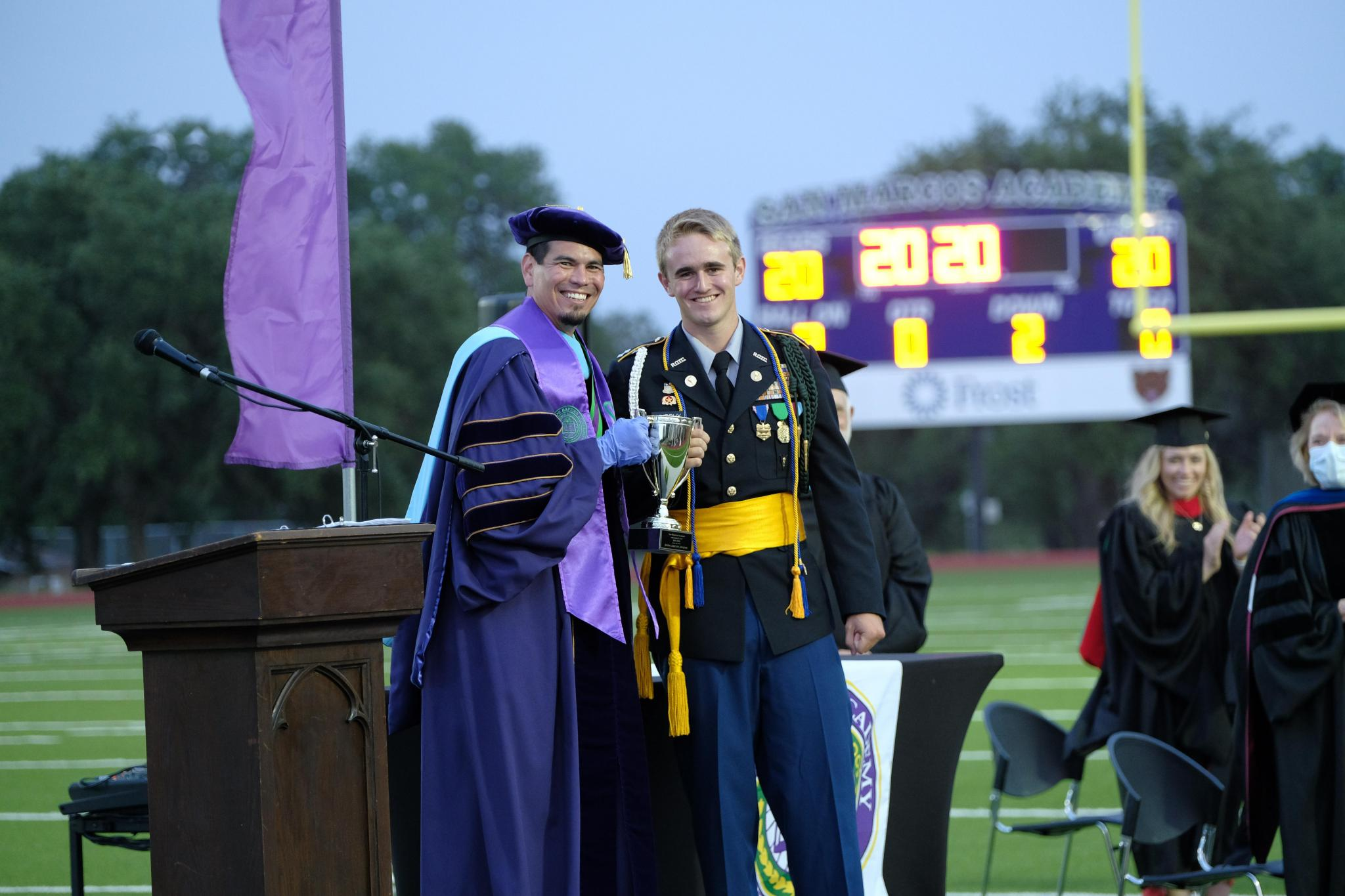 Gordon Murphy of Niederwald receives the President's Cup from Dr. Brian Guenther during the Commencement ceremony. This is the highest award a student can receive at the Academy. Murphy plans to enter the Texas Fire Academy next month to follow in his father's footsteps as a firefighter.