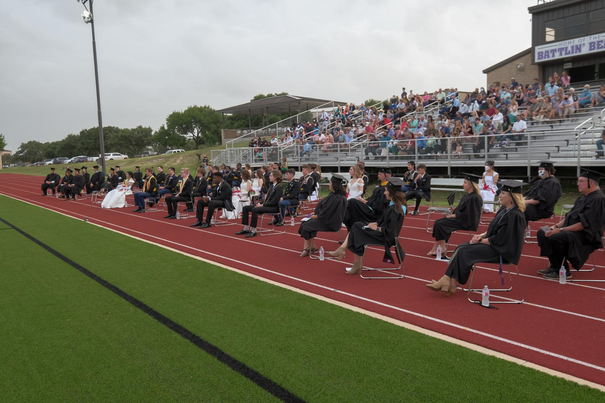 The Academy faculty joined the Class of 2020 on the track to provide social distancing during the Commencement ceremony. Originally scheduled for May 9, the ceremony was moved to June 27 due to the pandemic. Only 33 of the 46 SMA graduates, including several from other countries, were able to attend the ceremony.