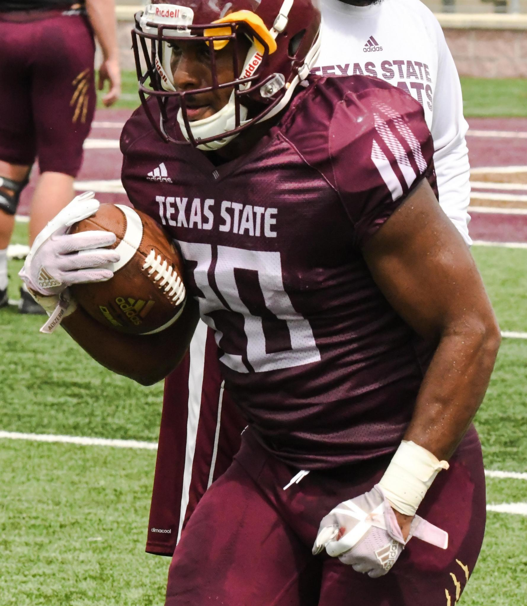Sophomore running back Robert Brown, Jr. rushes during Texas State's scrimmage on Saturday.