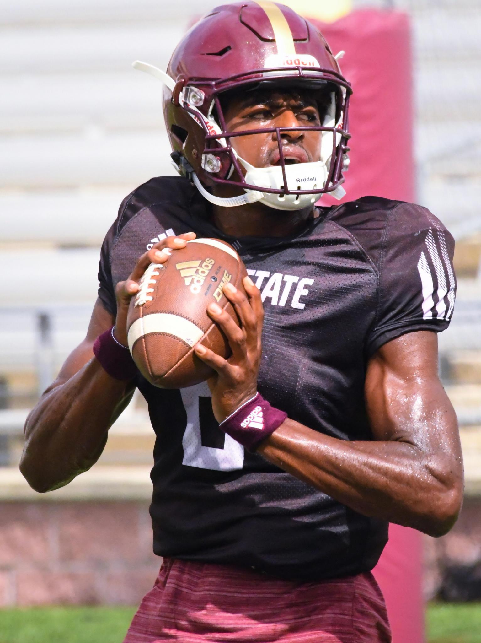 Sophomore quarterback Willie Jones III steps back to pass at Saturday's scrimmage inside Bobcat Stadium.