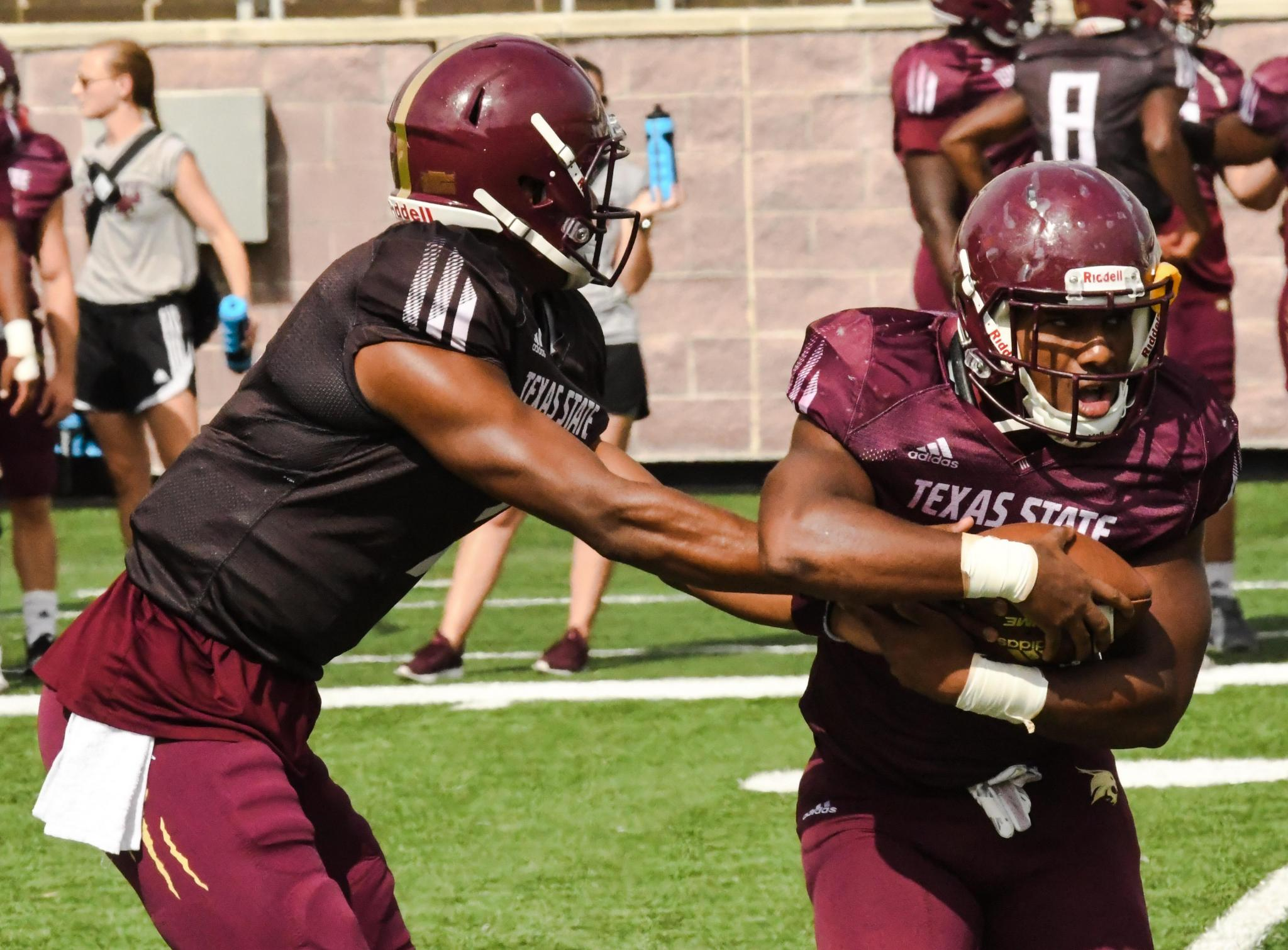 Redshirt freshman quarterback Jaylen Gipson hands off the ball during Texas State's scrimmage on Saturday