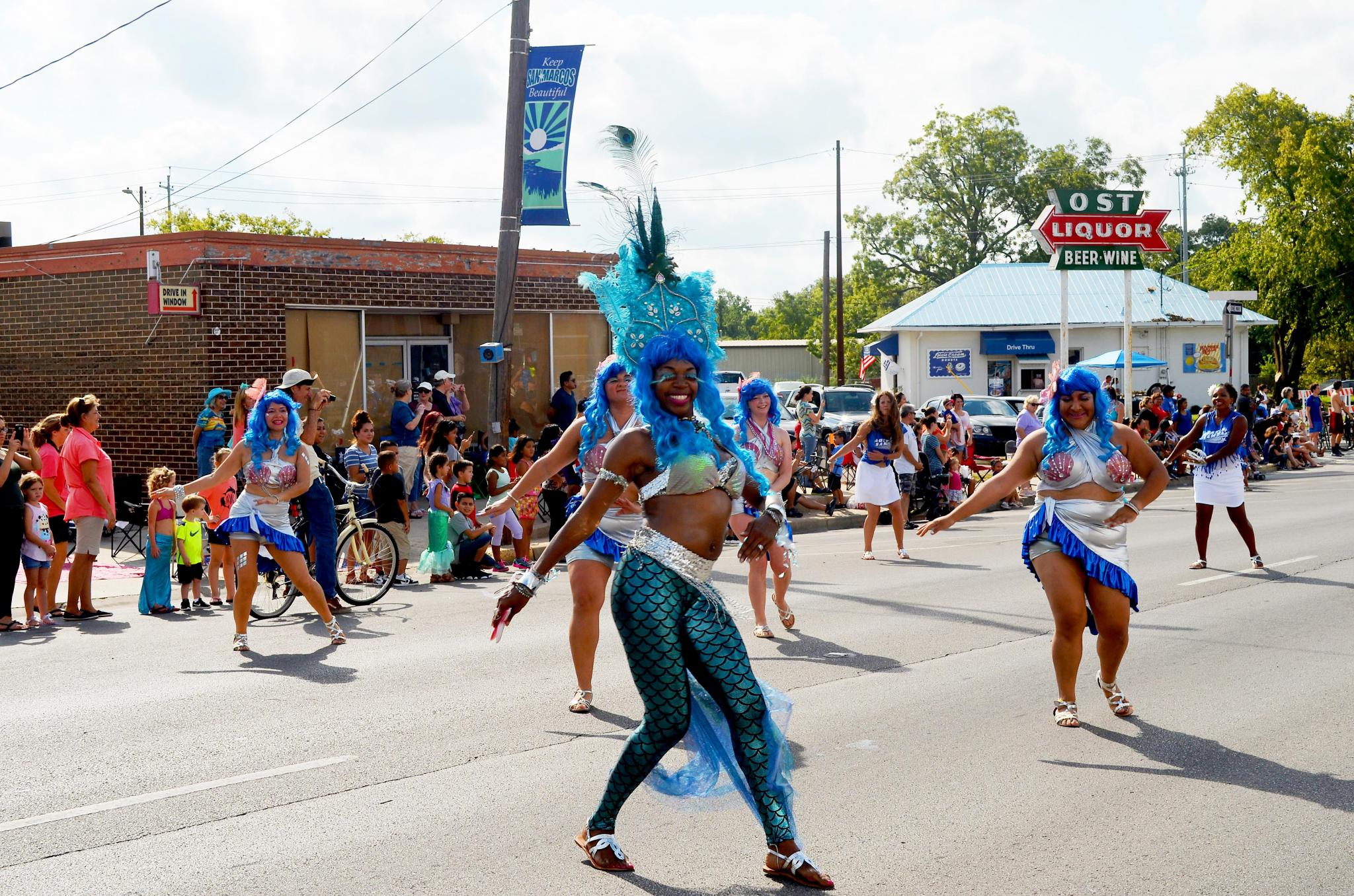 Austin Samba performers lead the way down the parade route in their elaborate costumes in the 2017 Mermaid Promenade.