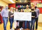 Local businesses receive Revive SMTX checks